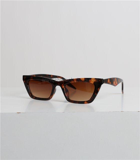 Γυαλιά ηλίου με μυτερό ταρταρούγα σκελετό και καφέ φακό