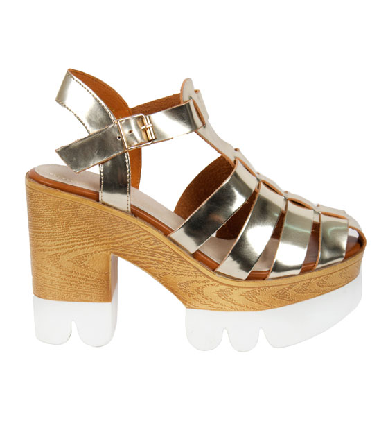 Heeled sandals in metallic gold straps