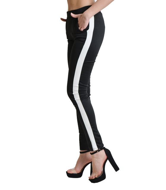 Black elastic trousers with white details on the side