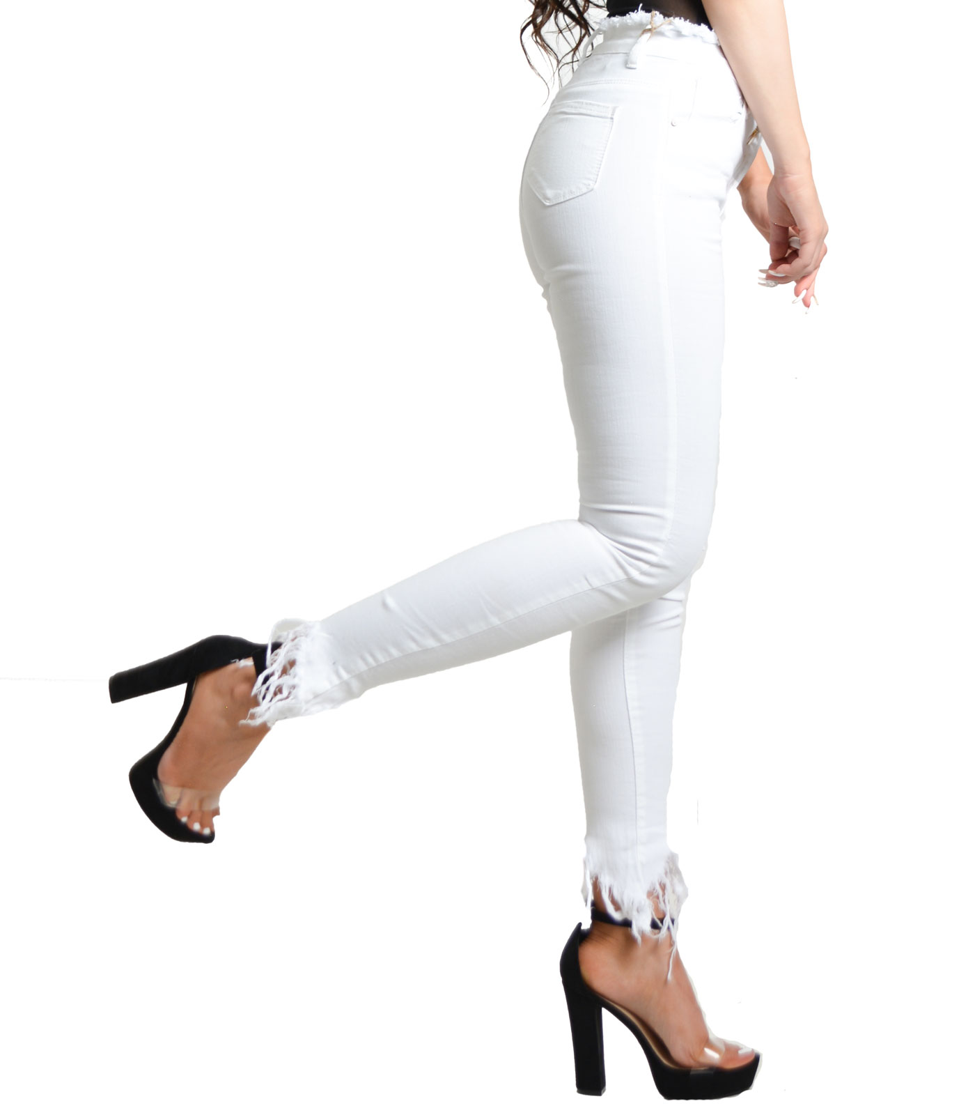 White tight jeans with asymmetric frayed hem