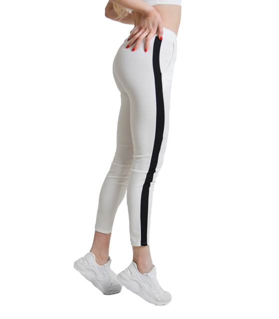 White elastic trousers with black details on the side