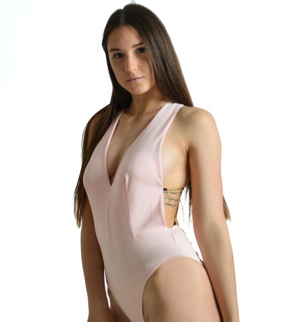 Ροζ κορμάκι με χρυσές αλυσίδες στην πλάτη